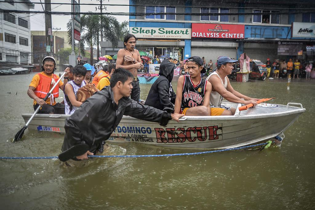 Flood victims are evacuated in a rescue boat after their homes were swamped by heavy flooding in Quezon city, suburban Manila, Philippines, Sept. 19, 2014.   NurPhoto—Corbis via Getty Images