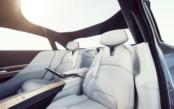 A view of the Lucid Air's back seat, with two plush-looking reclining seats trimmed in white leather.