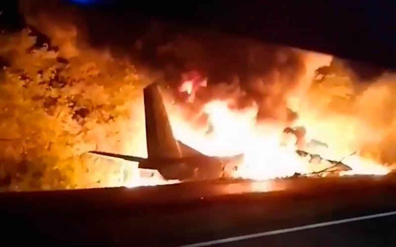 In this TV grab released by Ukraine's Emergency Situation Ministry, an AN-26 military plane bursts into flames after it crashed in the town of Chuguyiv close to Kharkiv