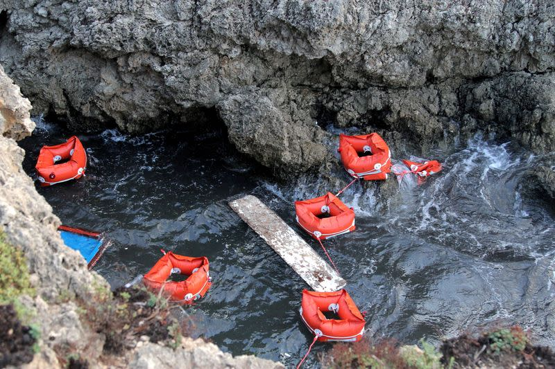 FILE PHOTO: Flotation devices are seen in the area where a migrant boat capsized off the Italian coast, on the island of Lampedusa