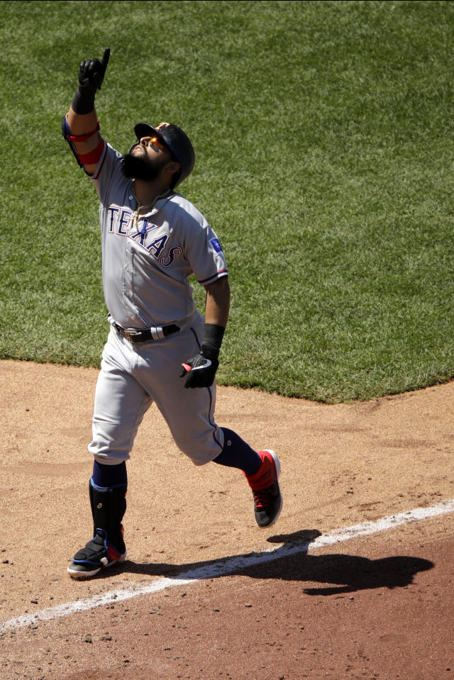 Texas Rangers' Rougned Odor celebrates as he heads home after hitting a two-run home run during the eighth inning of a baseball game Thursday, May 16, 2019, in Kansas City, Mo. The Rangers won 16-1. (AP Photo/Charlie Riedel)