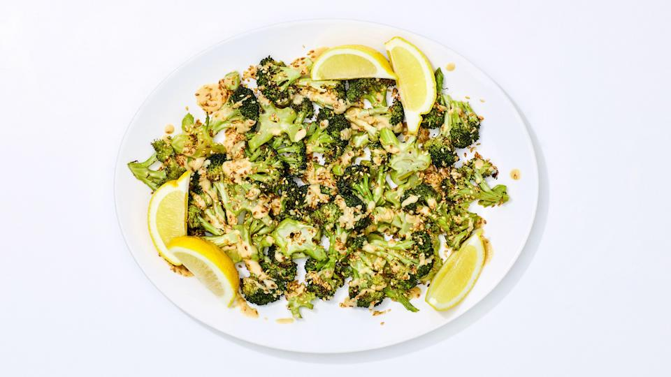 """Three simple things separate the kind of crispy, flavorful roasted vegetables that you could happily eat three nights a week from the kind that feel like a sad afterthought—and this roasted broccoli recipe gets it right. For one, making sure not to crowd the vegetables on the sheet pan ensures that they actually <em>roast</em>, not just steam. And cranking the heat—425°F is the sweet spot—helps to achieve exterior browning and caramelization more quickly, so that the veggies stay crisp-tender. Finally: SAUCE! Even the simplest, throw-together tahini sauce makes a platter of roasted broccoli feel a lot more special. And there you have it folks: roasted veggies you can <em>actually</em> get excited about. <a rel=""""nofollow noopener"""" href=""""https://www.bonappetit.com/recipe/crispy-roasted-broccoli-with-tahini-sauce?mbid=synd_yahoo_rss"""" target=""""_blank"""" data-ylk=""""slk:See recipe."""" class=""""link rapid-noclick-resp"""">See recipe.</a>"""