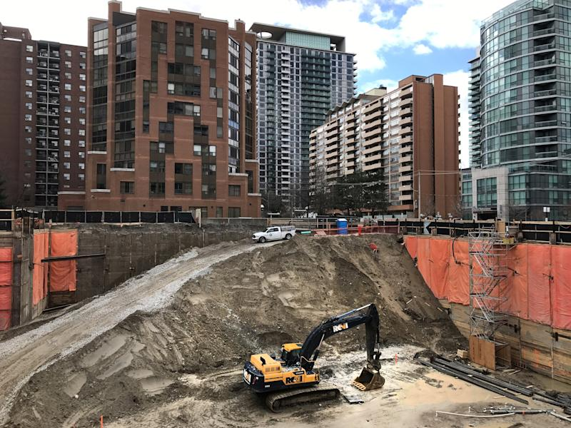 FILE PHOTO: Construction equipment is parked at the bottom of a pit on the site of a new condominium complex in Toronto