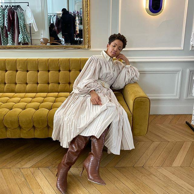 """<p>Put aside your favorite little white dresses in favor of one with maximalist appeal. There's no better fall pairing than an oversized shirt dress teamed with croc-embossed knee-high boots. </p><p><a href=""""https://www.instagram.com/p/CA-_b8ditgi/"""" rel=""""nofollow noopener"""" target=""""_blank"""" data-ylk=""""slk:See the original post on Instagram"""" class=""""link rapid-noclick-resp"""">See the original post on Instagram</a></p>"""