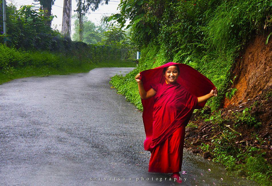 A young monk welcomes the rains joyously.