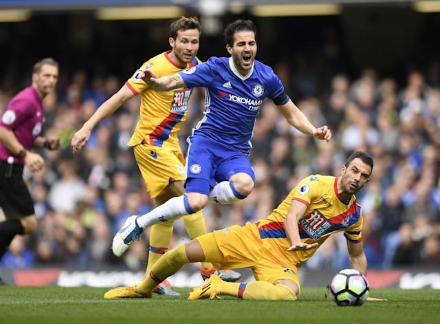 <p>Chelsea's Cesc Fabregas in action with Crystal Palace's Luka Milivojevic </p>