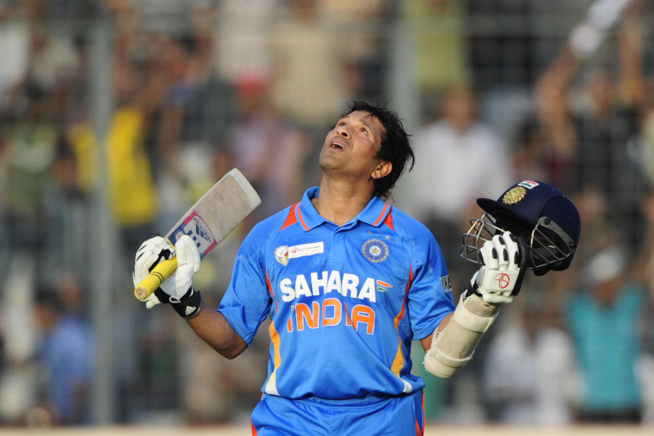 Indian batsman Sachin Tendulkar reacts after scoring his hundred century during the one day international (ODI) Asia Cup cricket match between India and Bangladesh at the Sher-e-Bangla National Cricket Stadium in Dhaka on March 16, 2012.  India's Sachin Tendulkar became the first batsman in history to score 100 international centuries, adding another milestone in his record-breaking career. AFP PHOTO/Munir uz ZAMAN (Photo credit should read MUNIR UZ ZAMAN/AFP/Getty Images)
