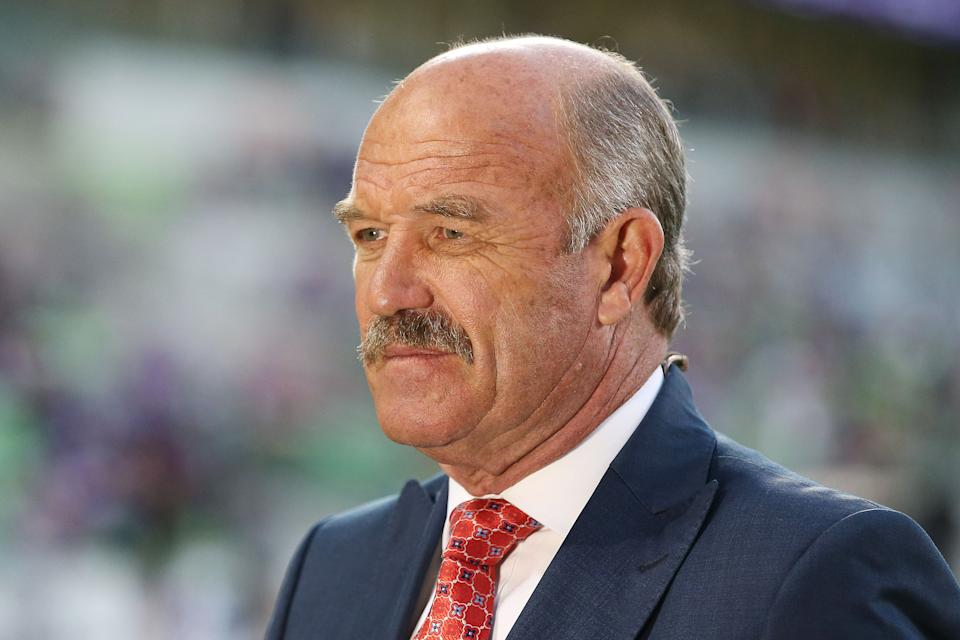Wally Lewis commentates on television during a NRL match.