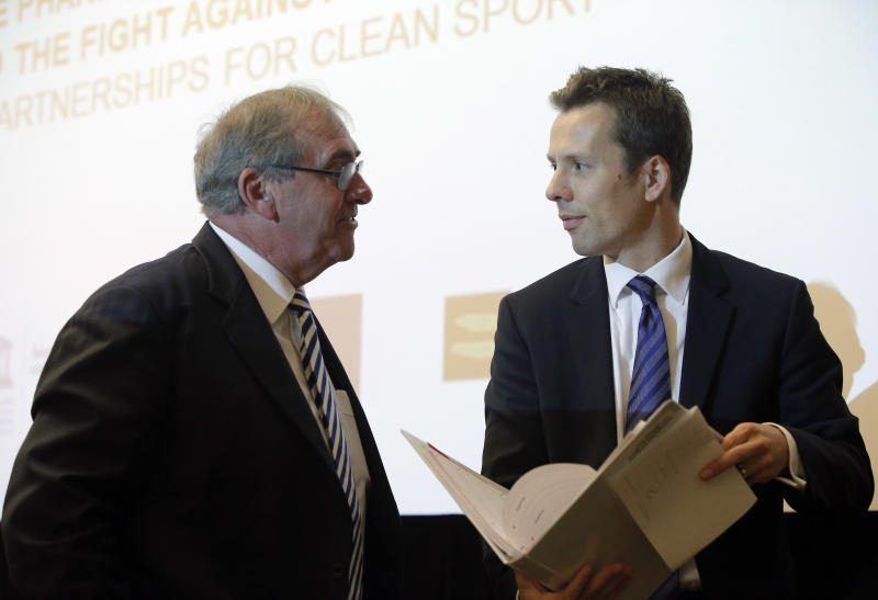 """John Fahey, the head of the World Anti-Doping Agency, left, speaks with GlaxoSmithKline SVP Global Communications Philip Thomson after the press conference ending the symposium called """"The Pharmaceutical Industry and the Fight against Doping : New Partnerships for Clean Sport"""" in Paris Monday, Nov. 12, 2012. The international conference is looking at ways to unite the pharmaceutical industry and sports authorites in the fight against doping (AP Photo/Francois Mori)"""