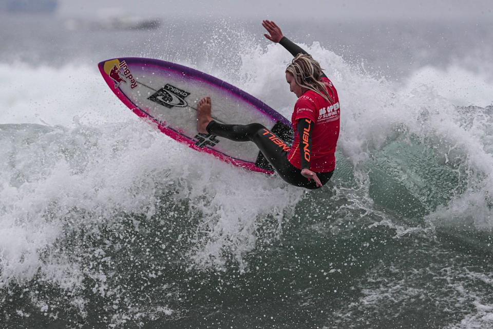 Caity Simmers competes in a preliminary heat to qualify for the final of the U.S. Open of Surfing