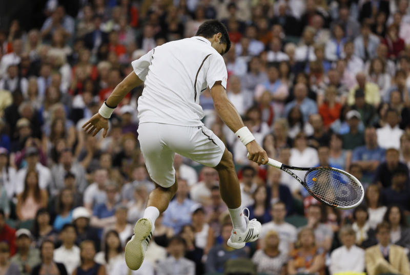 Novak Djokovic of Serbia jumps during his Men's second round singles match against Bobby Reynolds of the United States at the All England Lawn Tennis Championships in Wimbledon, London, Thursday, June 27, 2013. (AP Photo/Kirsty Wigglesworth)