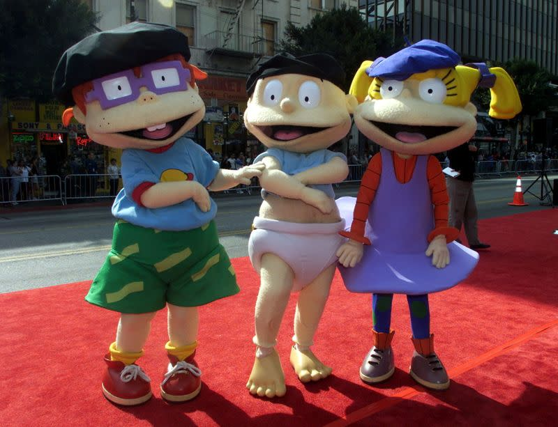 FILE PHOTO: Rugrats characters (L-R) Chuckie Finster, Tommy and Angelica Pickles pose for photographers at the ..