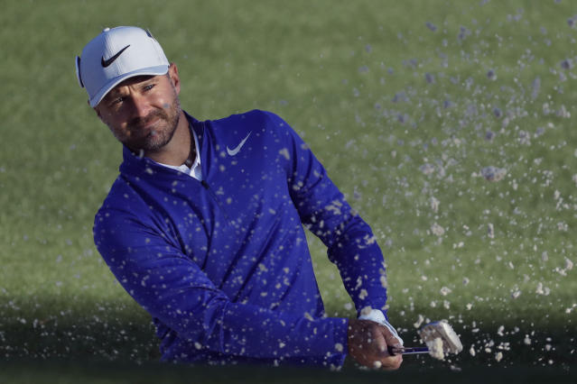 FILE - In this April 6, 2017, file photo, Trevor Immelman of South Africa, hits from a bunker on the second hole during the first round for the Masters golf tournament in Augusta, Ga. Immelman has been named International captain for the 2021 Presidents Cup matches in North Carolina. (AP Photo/Chris Carlson, File)