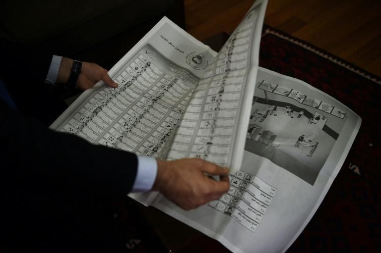 Voters in Kabul will wrestle with a newspaper-sized ballot paper with more than 800 candidates listed