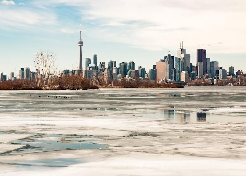 The Toronto skyline is seen here during the winter with melting ice covering Lake Ontario. Research suggests future winters will be warmer and more rainy in Canada's largest city. (Photo: Brady Baker/Getty Images)