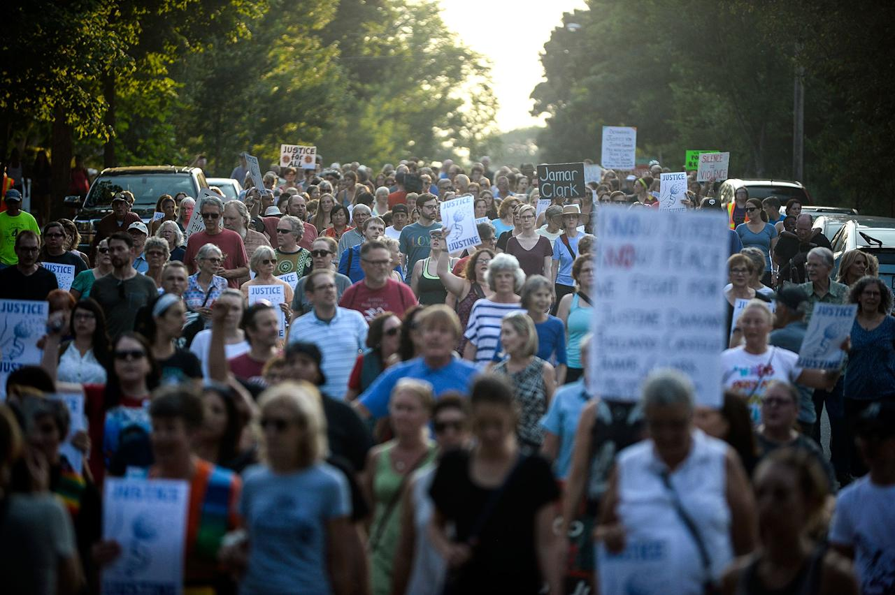 <p>Hundreds march from the site of Justine Damond's shooting to Beard's Plaissance Park during a march in honor of Damond Thursday, July 20, 2017, in Minneapolis, Minn. (Photo: Aaron Lavinsky/Star Tribune via AP) </p>