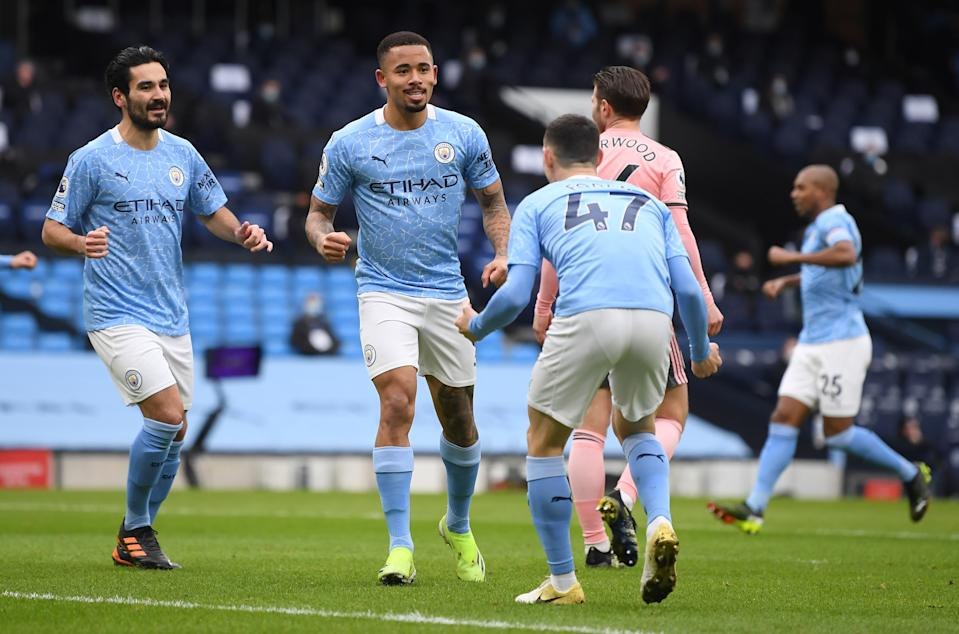 Manchester City's Gabriel Jesus (centre() celebrates scoring their first goal with teammates.