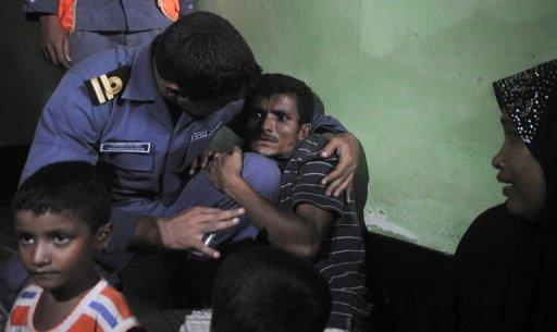 A Rohingya Muslim from Myanmar, who tried to cross the Naf river into Bangladesh to escape sectarian violence, cries in a Bangladeshi Coast guard station in Teknaf on June 19, 2012, before being sent back to Myanmar