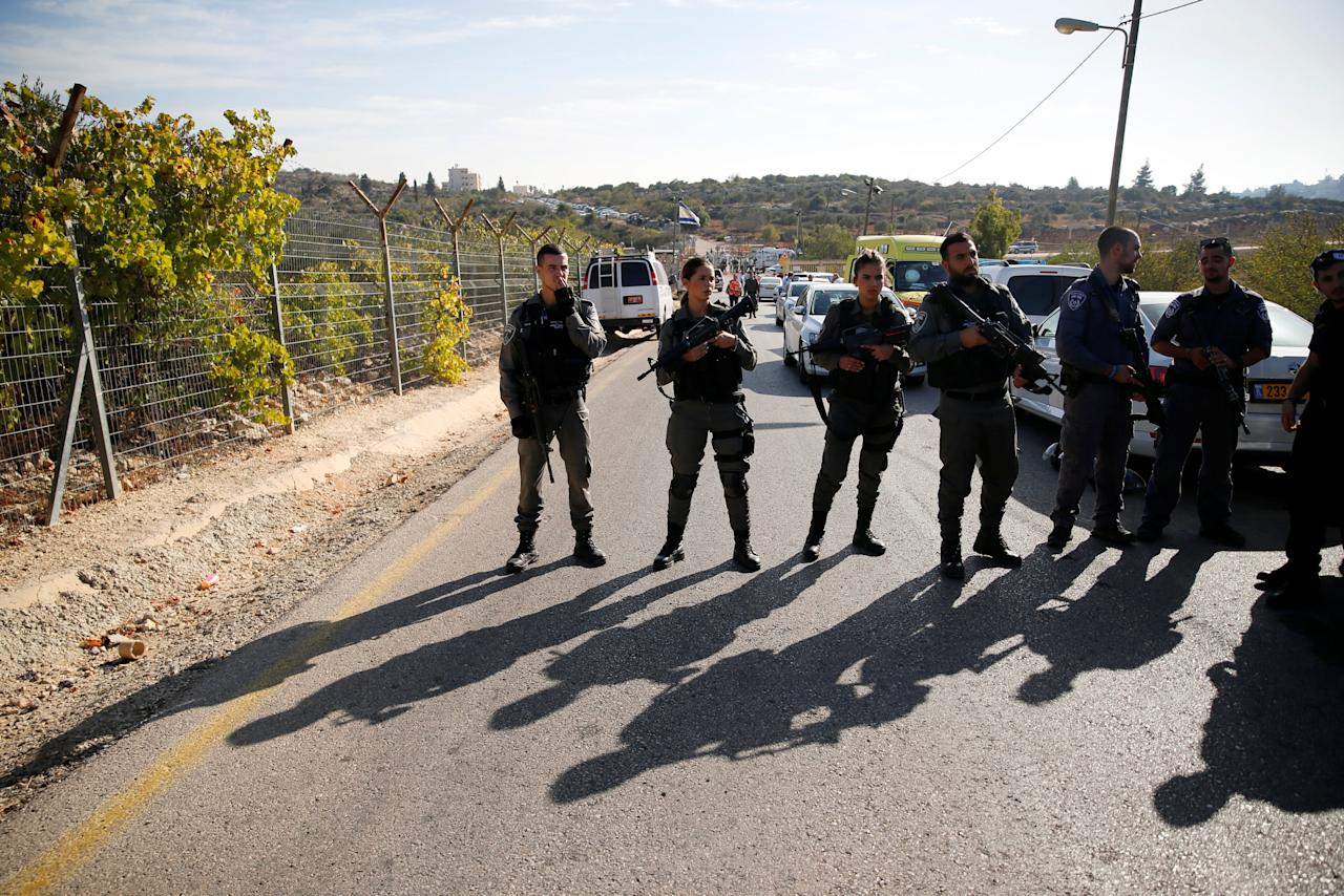 Israeli border policemen stand guard at the scene where a police spokeswoman said a Palestinian gunman killed three Israelis guards and wounded a fourth in an attack on a Jewish settlement in the occupied West Bank before himself being shot dead, September 26, 2017. REUTERS/Ammar Awad