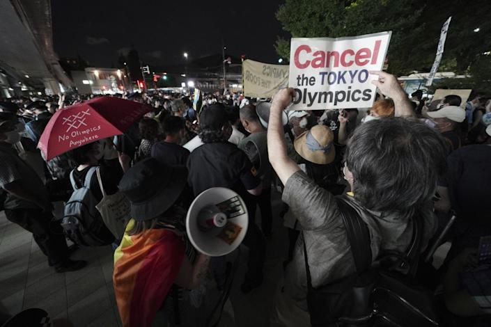 Anti-Olympic protesters demonstrate near the National Stadium in Tokyo.