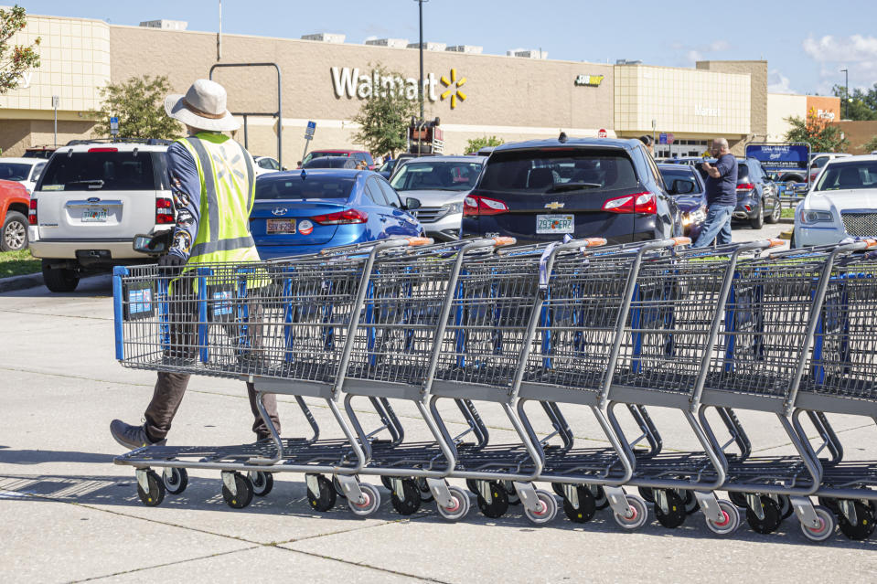 Florida, St. Cloud, Walmart, employee retrieving and returning shopping carts. (Photo by: Jeff Greenberg/Education Images/Universal Images Group via Getty Images)