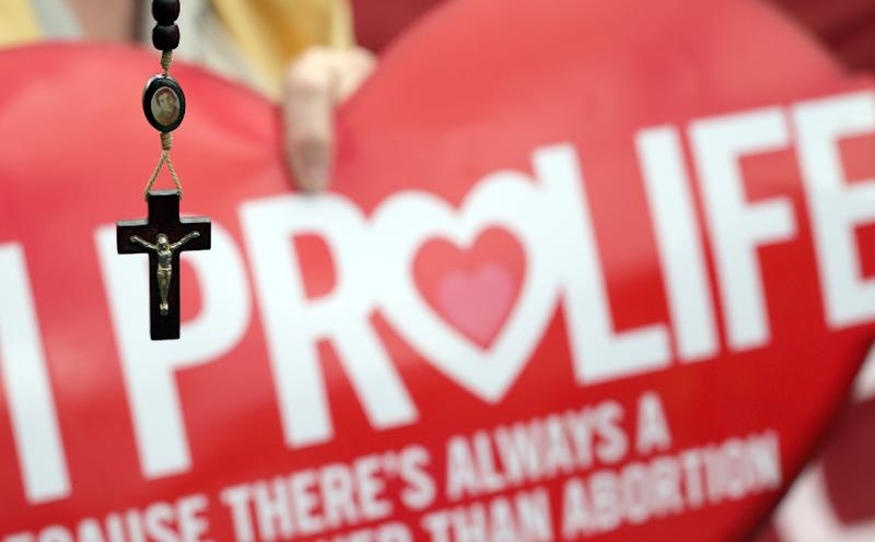 The prosecution of women in Northern Ireland over abortion has become a key campaign issue ahead of regional elections (AFP Photo/Paul Faith)