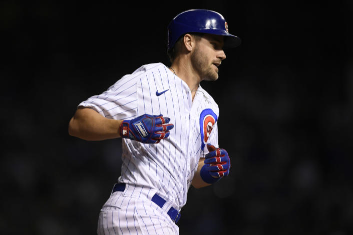 Chicago Cubs' Patrick Wisdom rounds the bases after hitting a solo home run during the eighth inning of a baseball game against the Cleveland Indians Tuesday, June 22, 2021, in Chicago. Chicago won 7-1. (AP Photo/Paul Beaty)