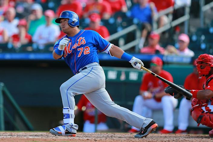 <p>New York Mets prospect Phillip Evans crushes a pitch for a home run in the ninth inning of a spring training baseball game against the St. Louis Cardinals at Roger Dean Stadium in Jupiter, Fla., Wednesday, March 1, 2017. Evans led the Eastern League in hitting last season. (Gordon Donovan/Yahoo Sports) </p>