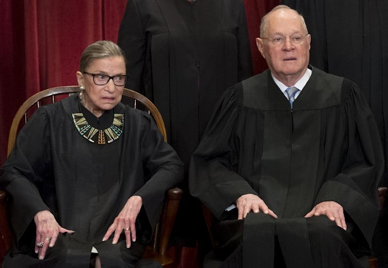 Supreme Court Justices Ruth Bader Ginsburg and Anthony Kennedy pose for an official photo