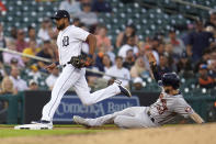 Detroit Tigers third baseman Jeimer Candelario beats Houston Astros' Kyle Tucker (30) to third base for the out in the fourth inning of a baseball game in Detroit, Thursday, June 24, 2021. (AP Photo/Paul Sancya)