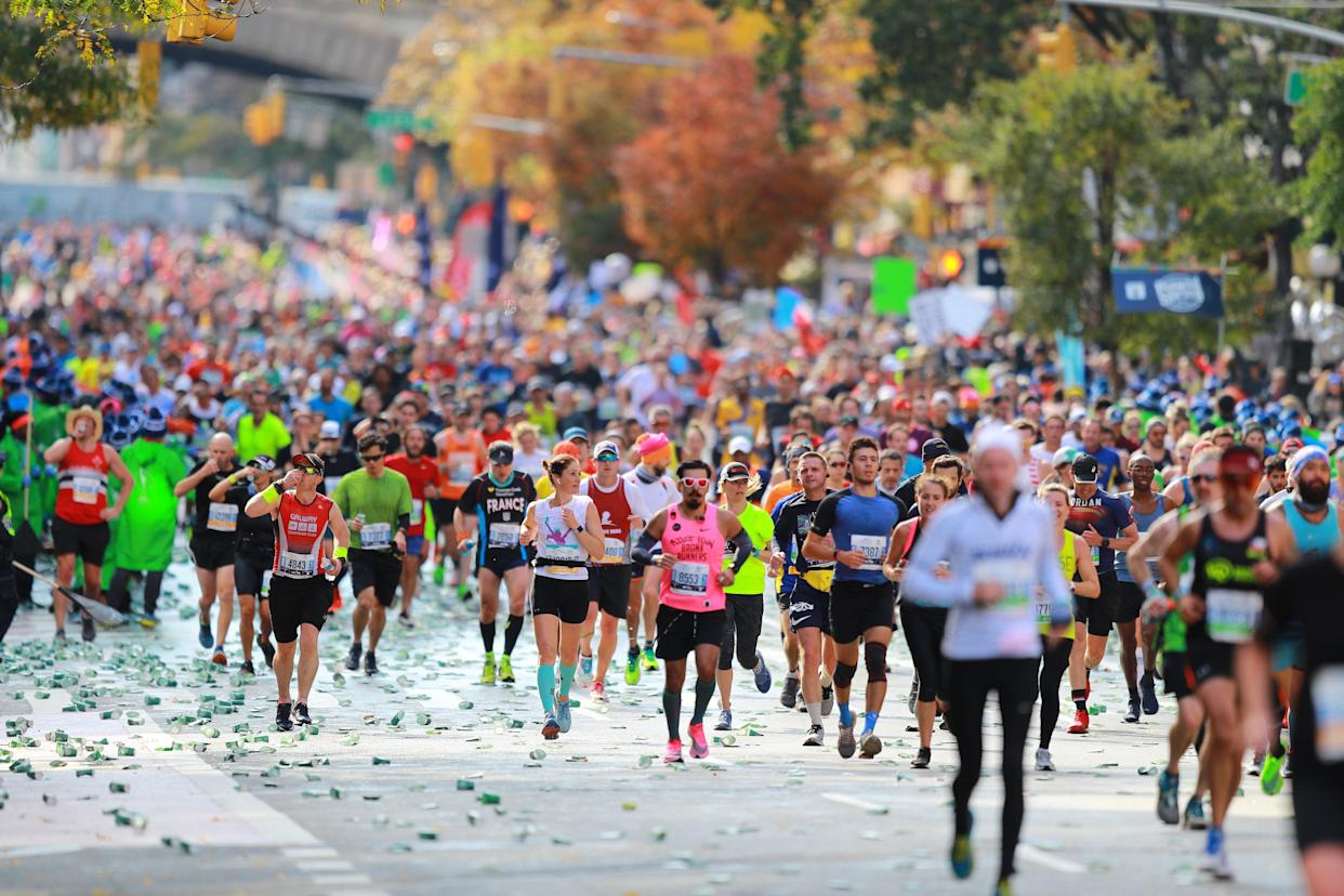Runners hit the 16th mile marker on First Avenue during the New York City Marathon. (Photo by Gordon Donovan/Yahoo News)