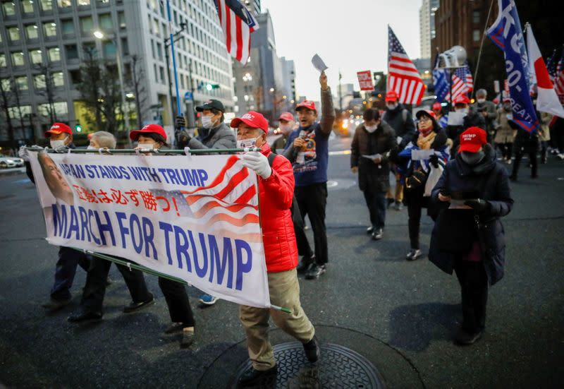 Supporters of U.S. President Donald Trump march ahead of the inauguration of President-elect Joe Biden, in Tokyo