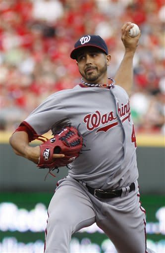 Washington Nationals starting pitcher Gio Gonzalez throws against the Cincinnati Reds during the first inning of a baseball game on Friday, May 11, 2012, in Cincinnati. (AP Photo/David Kohl)