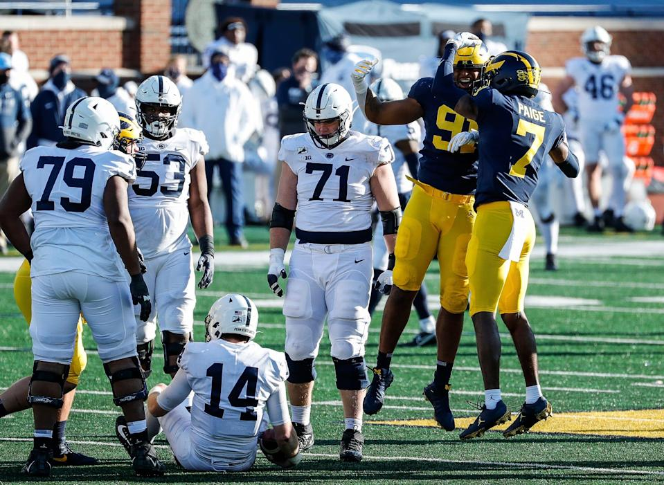 Michigan defensive lineman Taylor Upshaw, left, and defensive back Makari Paige celebrate after sacking Penn State quarterback Sean Clifford during the second half of Michigan's 27-17 loss at Michigan Stadium on Saturday, Nov. 28, 2020.
