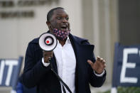 Mondaire Jones peaks at a Protect the Results rally, Wednesday, Nov. 4, 2020, in front of the Westchester County Courthouse in White Plains, N.Y. Jones and Ritchie Torres, both Democrats, became the first gay Black men elected to the U.S. House. (AP Photo/Kathy Willens)