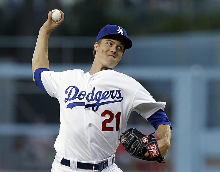 Los Angeles Dodgers starter Zack Greinke pitches to the Washington Nationals in the first inning of a baseball game in Los Angeles, Wednesday, May 15, 2013. (AP Photo/Reed Saxon)