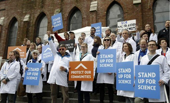 Scientists hold signs during a rally in conjunction with the American Geophysical Union's fall meeting Tuesday, Dec. 13, 2016, in San Francisco. (Photo: Marcio Jose Sanchez/AP)