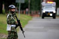 A soldier patrols around a military battalion where a car bomb exploded, according to authorities, in Cucuta
