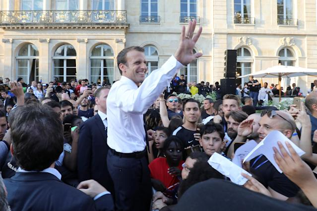 French President Emmanuel Macron welcomes supporters and players of the French national football team after they won the Russia 2018 World Cup final football match during a reception at the Elysee Presidential Palace, in Paris, France July 16, 2018. Ludovic Marin/Pool via Reuters