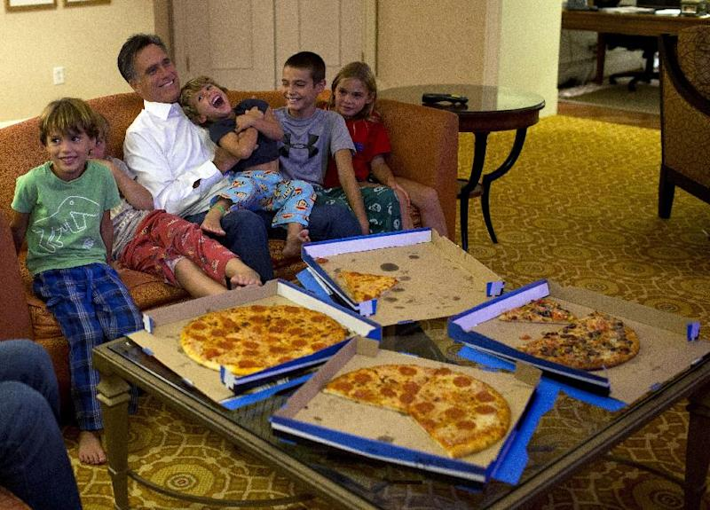 Republican presidential candidate, former Massachusetts Gov. Mitt Romney watches the Republican National Convention with his grandchildren from his hotel room on Wednesday, Aug. 29, 2012 in Tampa, Fla. (AP Photo/Evan Vucci)