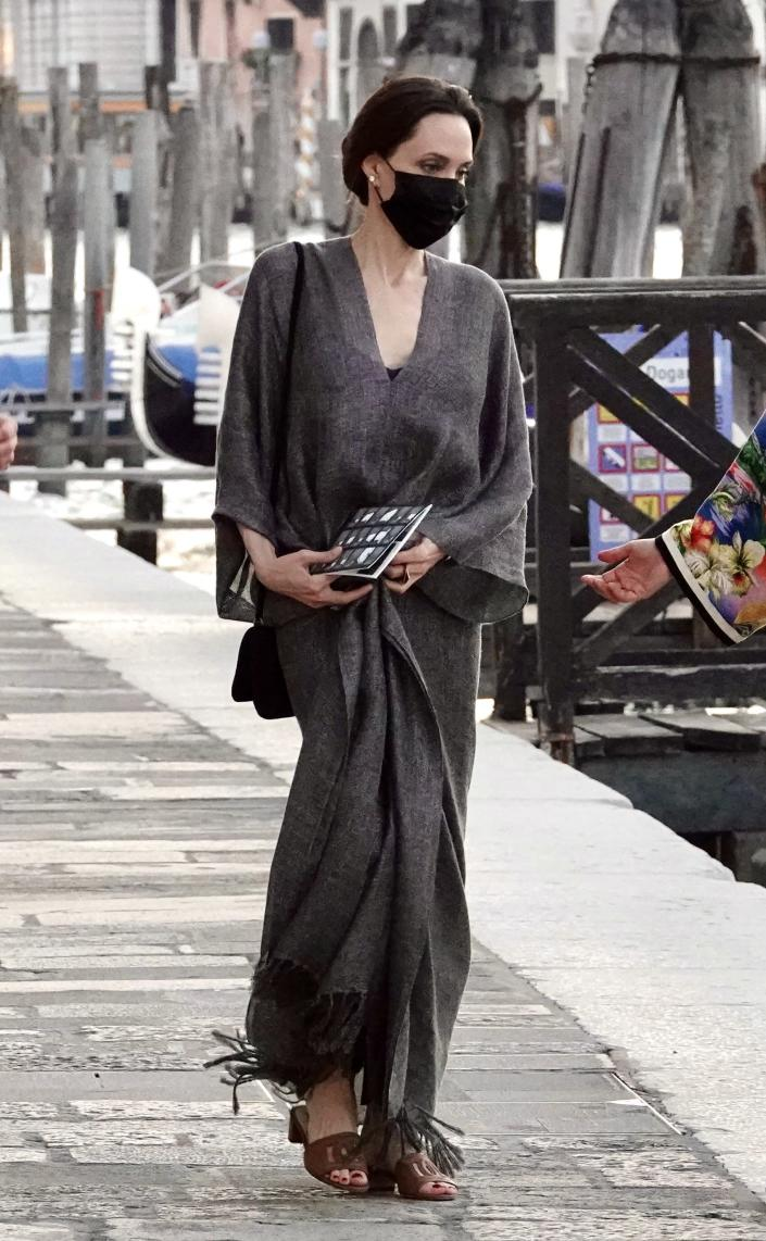 Angelina Jolie Is Elegant in Italy in Gray Caftan and Classic Brown Mules