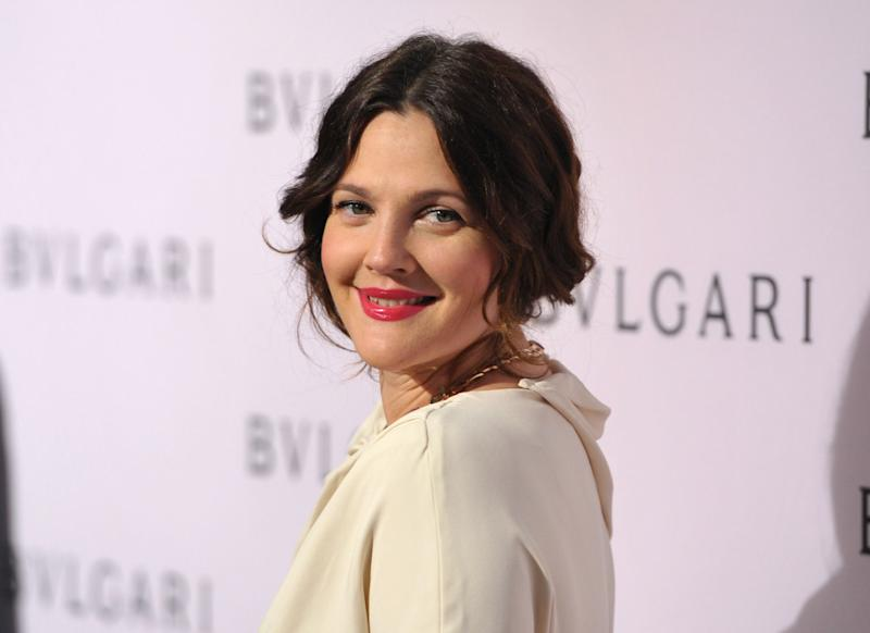 FILE - In this Feb. 19, 2013 file photo, Drew Barrymore arrives at BVLGARI's event celebrating Elizabeth Taylor and her magnificent BVLGARI jewel collection at BVLGARI Beverly Hills, in Beverly Hills, Calif. Fancy having Brad Pitt and Angelina Jolie, Barrymore and Dan Aykroyd over for dinner? You might start with an aperitif of Jolie and Pitt's new Miraval rose, move on to a light pasta dish served with Barrymore Wine's pinot grigio, then perhaps finish up with a glass of Canadian Aykroyd's cabernet franc ice wine for dessert. (Photo by John Shearer/Invision/AP, File)
