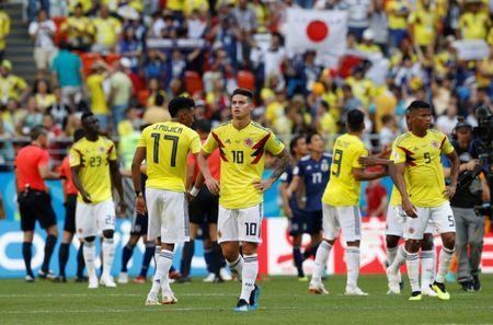 Soccer Football - World Cup - Group H - Colombia vs Japan - Mordovia Arena, Saransk, Russia - June 19, 2018 Colombia's James Rodriguez and team mates look dejected after the match REUTERS/Darren Staples