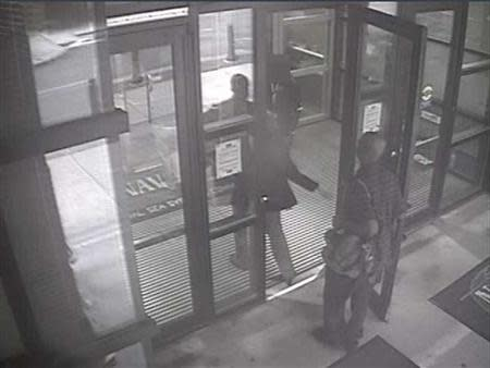 Aaron Alexis enters Building #197 at 8:08 a.m., carrying a backpack in this undated handout photo released by the FBI
