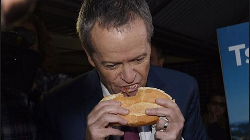 Bill Shorten came under fire for his unusual snag eating technique. Source: Twitter