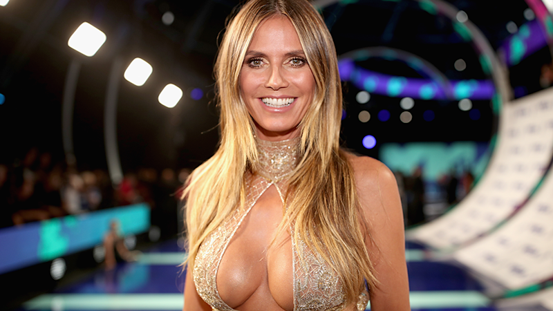 Heidi Klum German Supermodel 47 poses in cleavage top