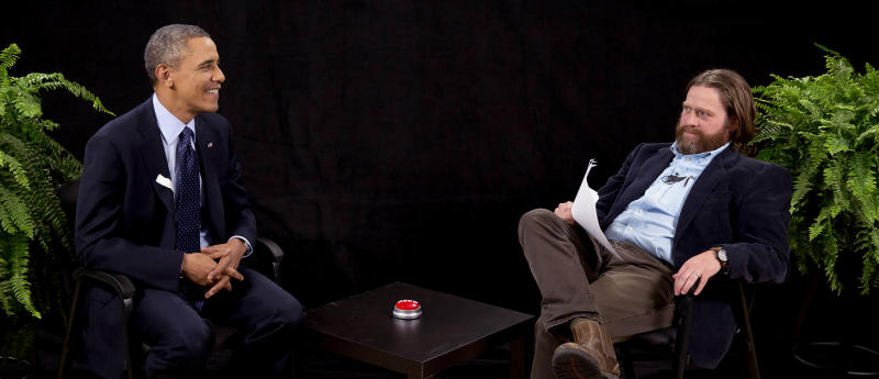 "This image from video released by Funny Or Die shows President Obama, left, with actor-comedian Zach Galifianakis during an appearance on ""Between Two Ferns,"" the digital short with a laser focus on reaching people aged 18 to 34. The president urged young people to sign up for the new health care plan through an appearance posted Tuesday, March 11, 2014, on the comic website Funny or Die, bypassing TV talk show titans like Jimmy Fallon or Jimmy Kimmel for an online audience. (AP Photo/Funny Or Die)"