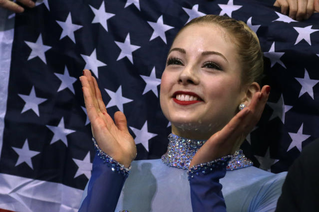 Gracie Gold of the United States applauds in the results area after competing in the women's team free skate figure skating competition at the Iceberg Skating Palace during the 2014 Winter Olympics, Sunday, Feb. 9, 2014, in Sochi, Russia. (AP Photo/Darron Cummings, Pool)
