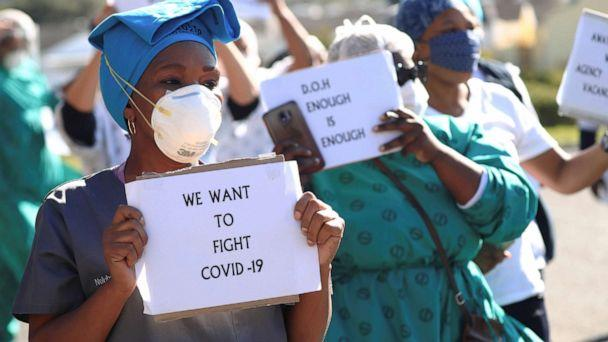 PHOTO: Health care workers holding signs, protest over the lack of personal protective equipment (PPE) during the coronavirus outbreak, outside a hospital in Cape Town, South Africa, June 19, 2020. (Mike Hutchings/Reuters)
