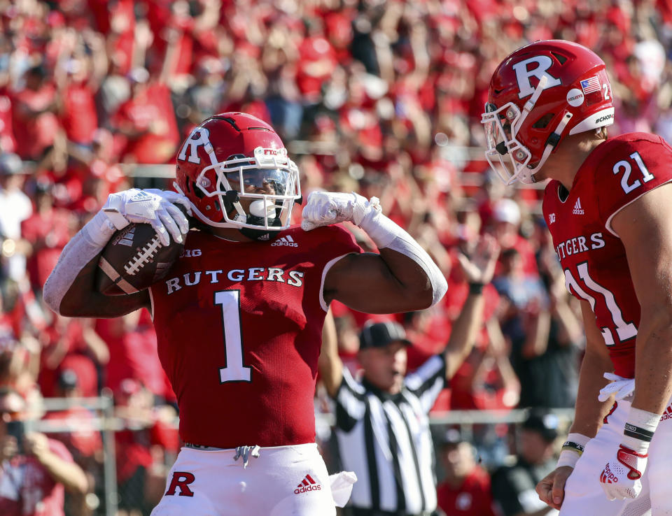 Rutgers running back Isaih Pacheco (1) reacts after he rushed for a 20-yard touchdown during the first half of an NCAA college football game against Delaware, Saturday, Sept. 18, 2021, in Piscataway, N.J. (Andrew Mills/NJ Advance Media via AP)